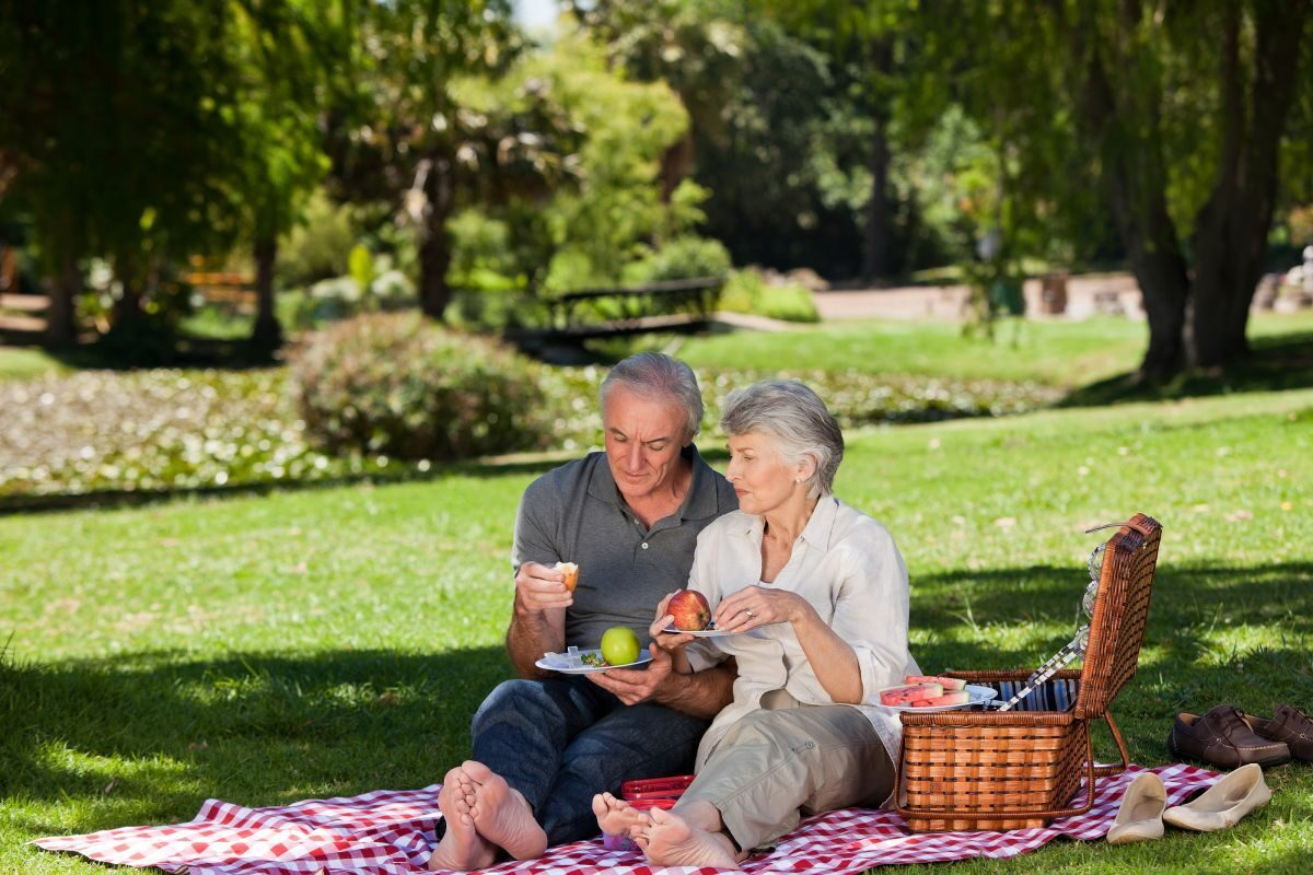 bigstock_elderly_couple_picnicking_in__13798364